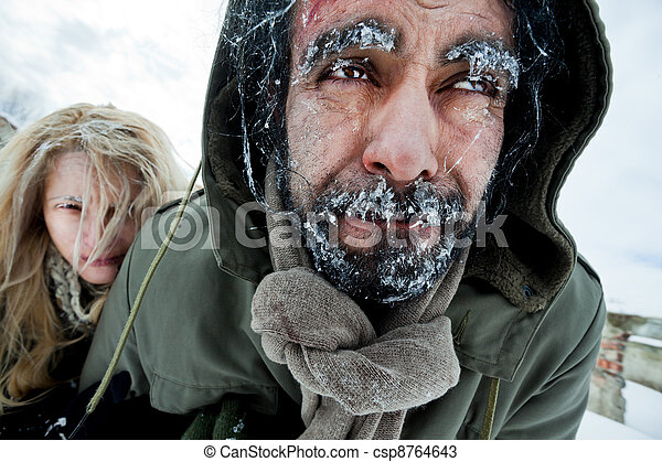 Freezing struggling couple survivers - csp8764643