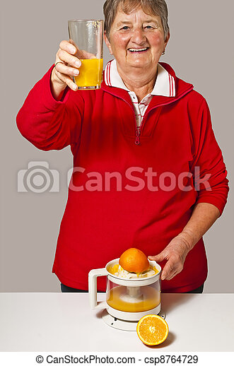 pensioner drinks orange juice - csp8764729