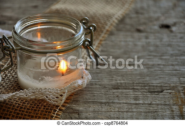 white candle in the jar - csp8764804