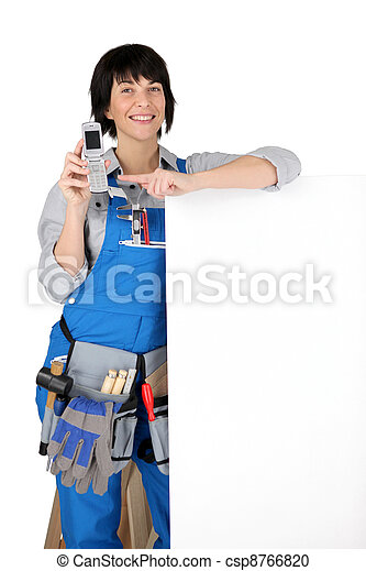 a female artisan showing a cell phone - csp8766820