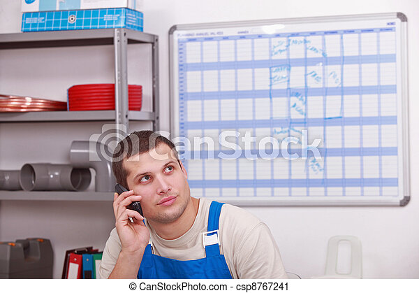 Man ordering parts to complete inventory - csp8767241