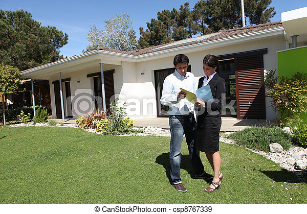 Real estate agent doing a viewing - csp8767339