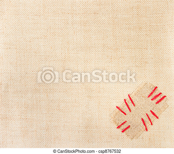 Patch with red stitch over burlap background. Sackcloth with copy space - csp8767532