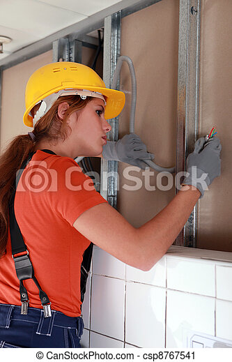 Female electrician working on wiring - csp8767541