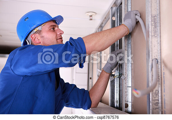 Electrician installing wiring - csp8767576