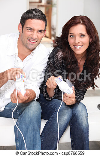 Competitive couple playing video games - csp8768559