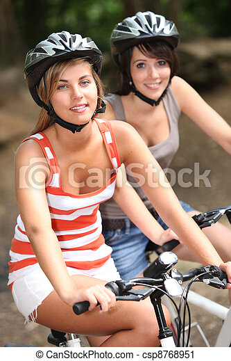 Two girls on a bicycle - csp8768951