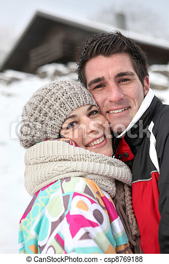 Couple enjoying their alpine getaway - csp8769188