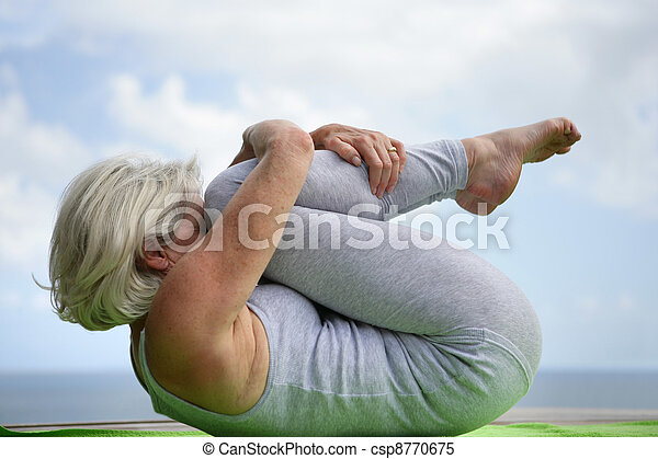 Woman holding a yoga position - csp8770675