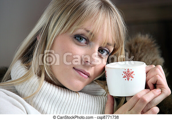 Woman chilling-out with coffee on sofa - csp8771738