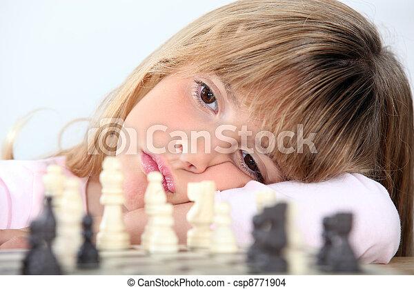 Bored girl playing chess