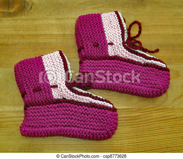 Hand knitted baby booties - csp8773628