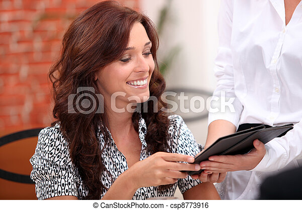 Woman watching the bill in a restaurant - csp8773916