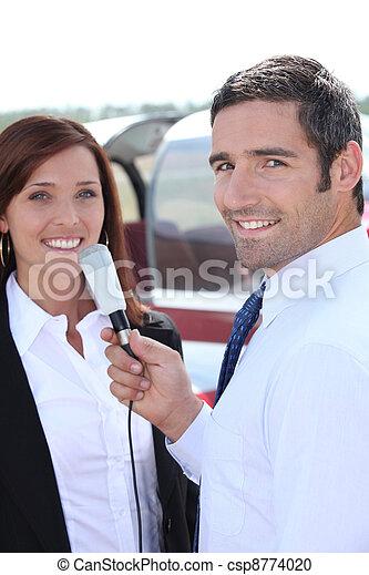 A journalist interviewing woman - csp8774020