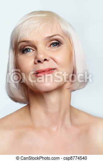 Smiling mature woman - csp8774540. Portrait of a nude senior woman smiling ...