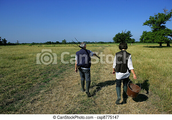 Farming couple in a field - csp8775147
