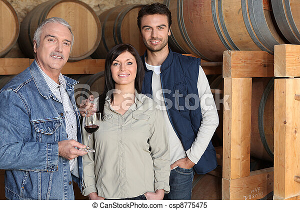 Winemaker giving a tour of his winery - csp8775475