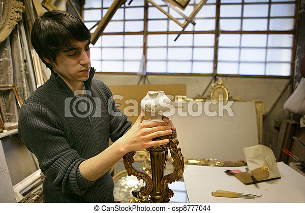 An artisan sculpting a lamp - csp8777044
