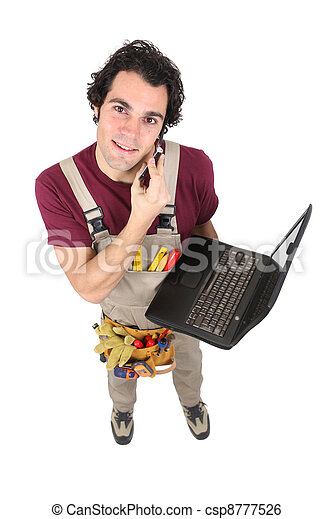 Laborer in dungarees with mobile phone and computer - csp8777526