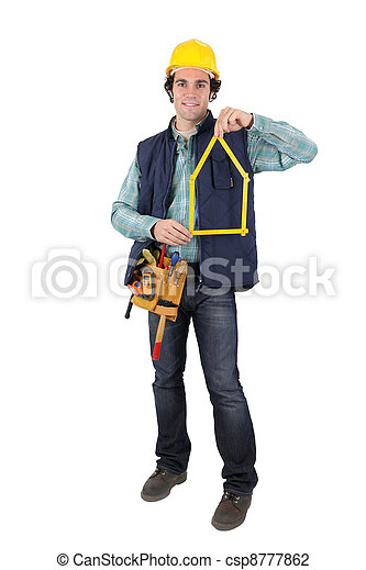 Man holding tool in shape of house - csp8777862