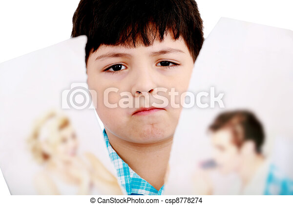 Upset boy standing in front pcture of parents with problems against white background  - csp8778274