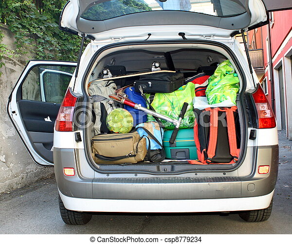 very car with the trunk full of luggage ready for the departure - csp8779234