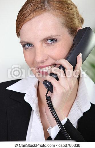 Portrait of smiling receptionist - csp8780838