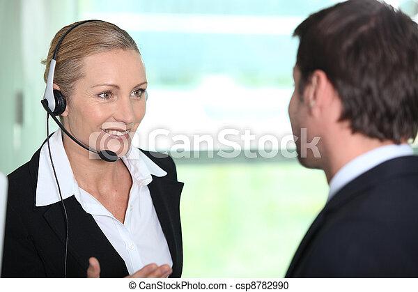 Woman informing man - csp8782990
