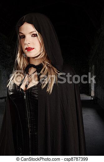 Female vampire in hooded cape - csp8787399