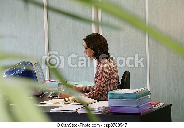 Young receptionist typing on keyboard - csp8788547