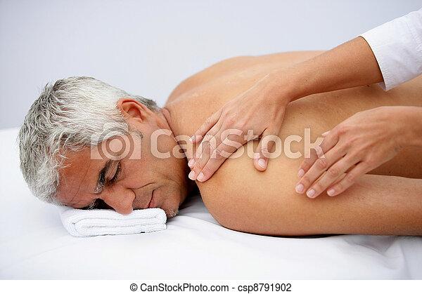 Laid man being massaged - csp8791902