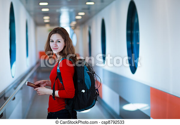 young woman  boarding an aircraft - csp8792533