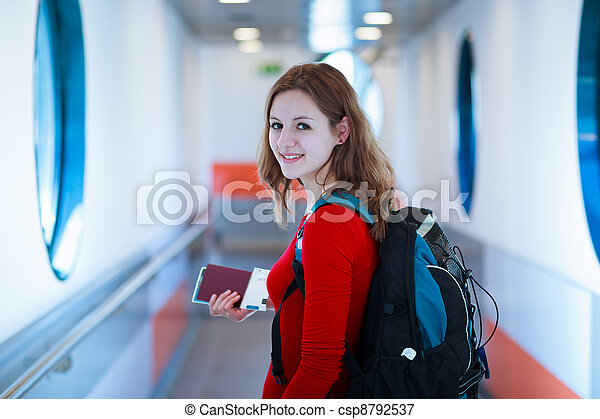 young woman  boarding an aircraft - csp8792537
