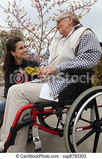 Young woman with an elderly lady in a wheelchair - csp8793303