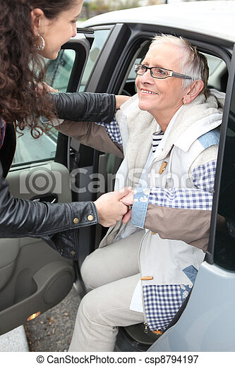 Young woman assistant old lady out of care - csp8794197