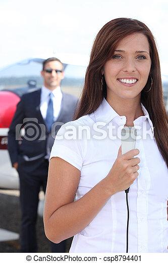 Journalist at airport - csp8794401