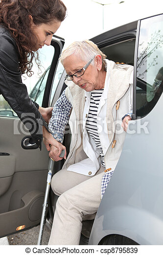 grandma with homehelper outdoors - csp8795839