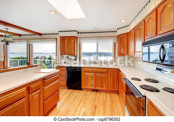 Photo de clair bois confortable cuisine eau vue blanc csp8796302 - Cuisine couleur miel ...