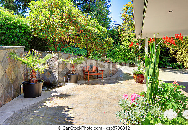 House exterior Front yard with flowers and ceramic tiles - csp8796312