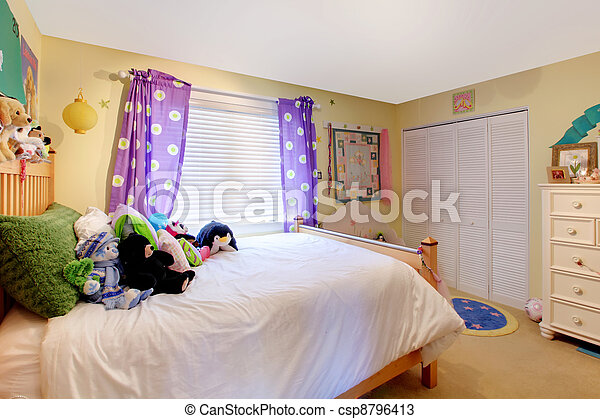 Baby girl room with toys and purple curtains. - csp8796413