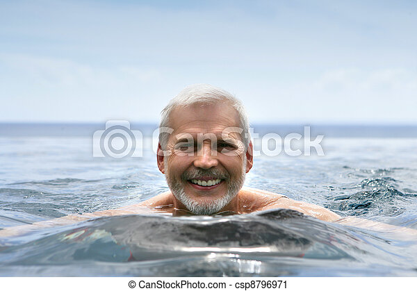 Elderly man swimming - csp8796971