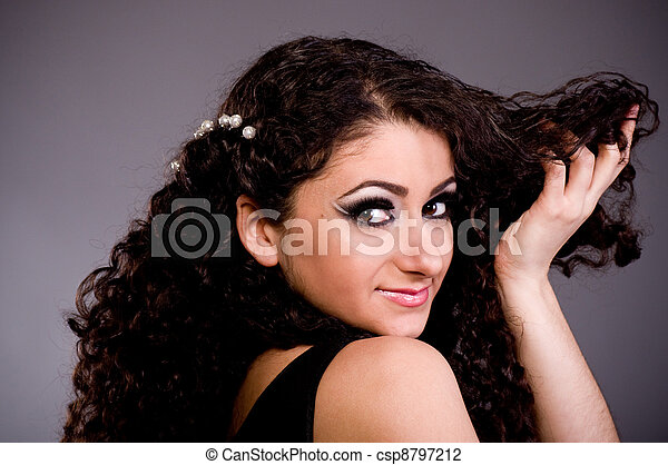 woman with long ringlets hair - csp8797212