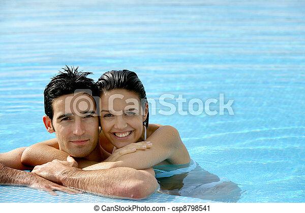 beautiful couple in a swimming pool - csp8798541