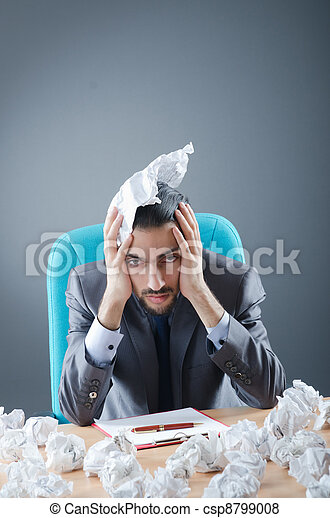 Businessman with lot of discarded paper - csp8799008