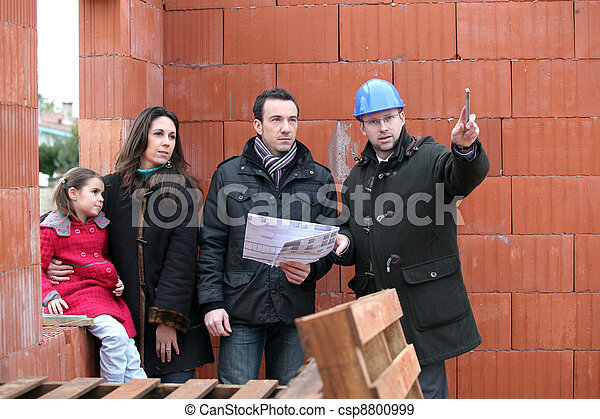 Couple having their new home inspected by an engineer - csp8800999