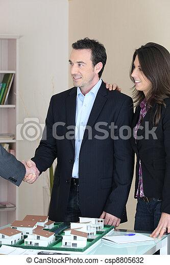 Couple discussing a housing development - csp8805632