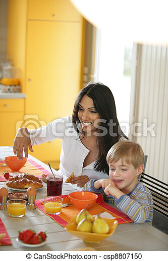 Mother and son at the breakfast table