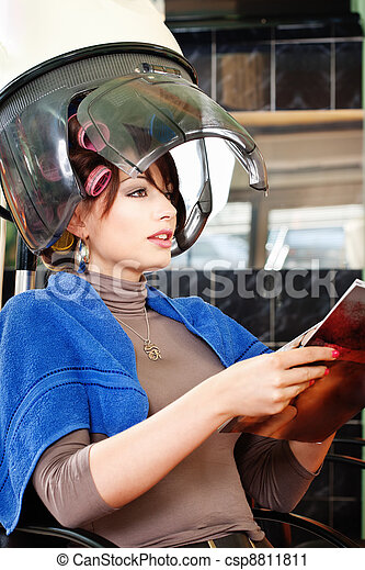 Pretty woman under bonnet hair dryer - csp8811811