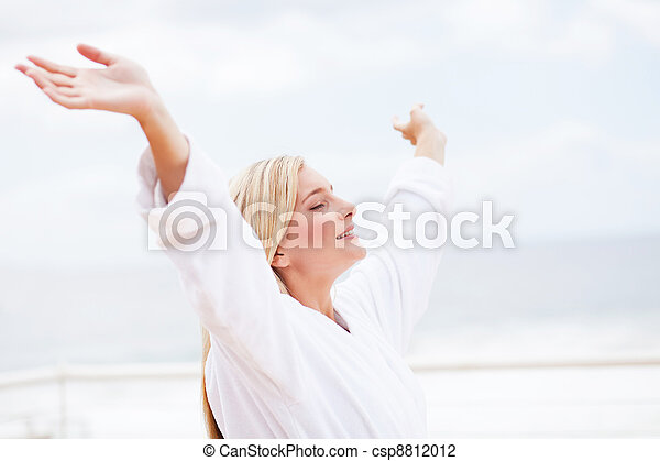 cute young woman in bathrobe with her arms opened - csp8812012