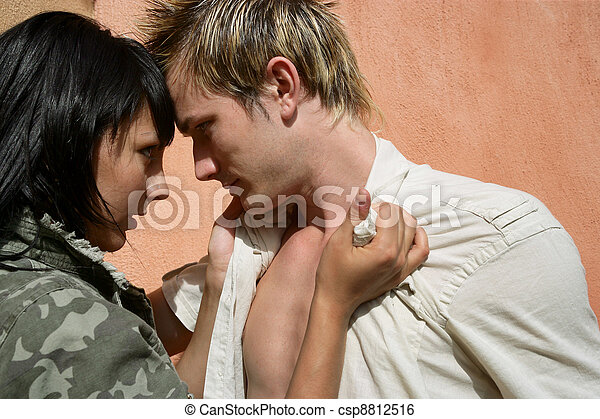 Provocative couple stood by wall - csp8812516